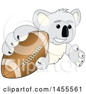 Clipart Of A Koala Bear School Mascot Character Grabbing A Football Royalty Free Vector Illustration by Toons4Biz