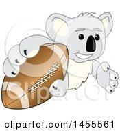 Koala Bear School Mascot Character Grabbing A Football