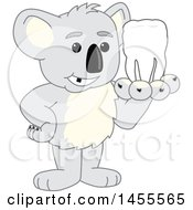 Clipart Of A Koala Bear School Mascot Character Holding A Tooth Royalty Free Vector Illustration by Toons4Biz
