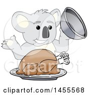 Koala Bear School Mascot Character Serving A Roasted Thanksgiving Turkey