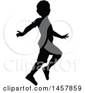 Black Silhouetted Boy Skipping