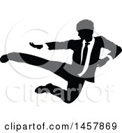 Clipart Of A Black And White Silhouetted Business Man Kicking Royalty Free Vector Illustration