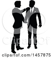 Clipart Of Black And White Silhouetted Business Men Shaking Hands Royalty Free Vector Illustration by AtStockIllustration