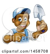 Clipart Of A Cartoon Happy Black Male Gardener In Blue Holding A Garden Trowel And Pointing Royalty Free Vector Illustration