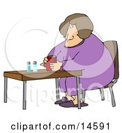 Tired Woman In Purple Pajamas And Slippers Sitting At A Table And Drinking Coffee While Zoning Out In The Morning
