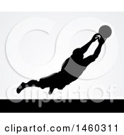 Black Silhouetted Goal Keeper Soccer Player Blocking The Ball Over Gray