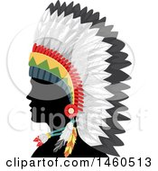Silhouetted Native American Indian Man In A Feather Headdress And In Profile