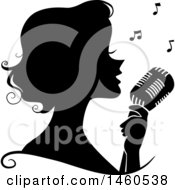 Clipart Of A Black And White Silhouetted Woman Singing Into A Microphone Royalty Free Vector Illustration