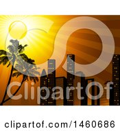 City Skyline With An Orange Sunset Sky And Palm Trees