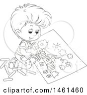 Black And White Boy Coloring A Page Of A House
