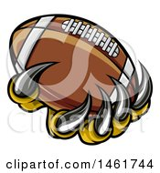 Clipart Of Monster Or Eagle Claws Holding A Football Royalty Free Vector Illustration
