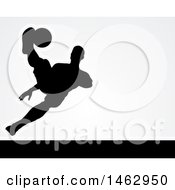 Black Silhouetted Male Soccer Player Kicking Over Light Gray