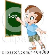Smart School Boy Solving An Addition Math Problem On A Chalk Board