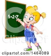 Smart School Girl Solving An Addition Math Problem On A Chalk Board