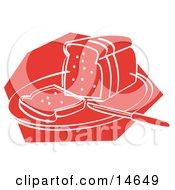 Knife Resting On A Cutting Board Near Sliced Bread