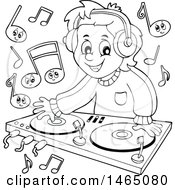 Black And White Male Dj Wearing Headphones And Mixing Records