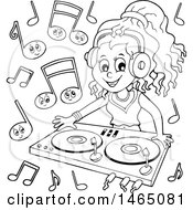 Black And White Female Dj Wearing Headphones And Mixing Records