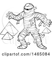 Clipart Of A Black And White Mummy And Pyramids Royalty Free Vector Illustration by visekart