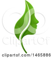 Clipart Of A Green Leaf And Profiled Face Royalty Free Vector Illustration