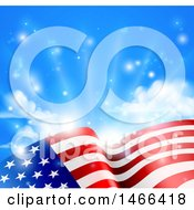 Clipart Of A Rippling American Flag Under Blue Sky With Sunshine Royalty Free Vector Illustration by AtStockIllustration