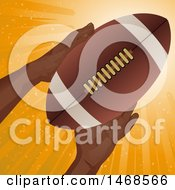 Clipart Of A Pair Of Hands Holding A Football Over Orange Rays Royalty Free Vector Illustration by elaineitalia