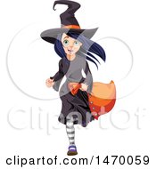 Girl Trick Or Treater Running In A Witch Halloween Costume