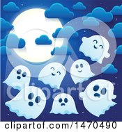 Group Of Halloween Ghosts Under A Full Moon
