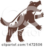 Clipart Of A Retro Attacking Wolverine Skunk Bear Royalty Free Vector Illustration by patrimonio