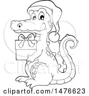 Clipart Of A Christmas Crocodile Holding A Gift Black And White Royalty Free Vector Illustration