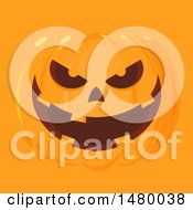 Grinning Evil Halloween Jackolantern Pumpkin On Orange