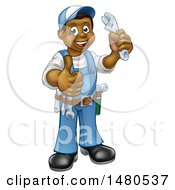 Clipart Of A Cartoon Full Length Black Male Plumber Holding An Adjustable Wrench And Giving A Thumb Up Royalty Free Vector Illustration by AtStockIllustration