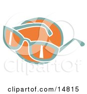 Pair Of Orange And Green Sunglasses Over An Orange Circle Clipart Illustration