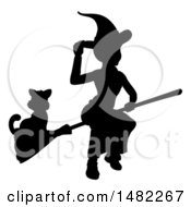 Silhouetted Witch Tipping Her Hat And Flying On A Broomstick With A Cat