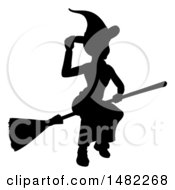 Silhouetted Witch Tipping Her Hat And Flying On A Broomstick