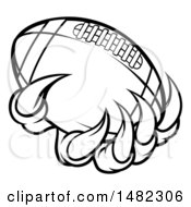 Clipart Of Black And White Monster Or Eagle Claws Holding A Football Royalty Free Vector Illustration