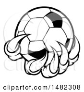 Clipart Of Black And White Monster Or Eagle Claws Holding A Soccer Ball Royalty Free Vector Illustration