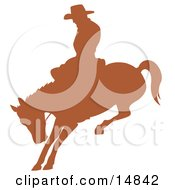 Brown Silhouette Of A Cowboy Riding A Bucking Bronco In A Rodeo