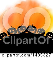 Silhouetted Hill With Halloween Jackolantern Pumpkins Over Orange Watercolor
