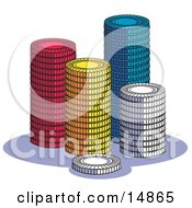 Stacks Of Red Yellow Blue And White Poker Chips In A Casino