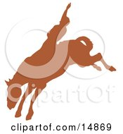 Brown Silhouette Of A Cowboy Riding A Bucking Bronco And Holding One Arm Up In The Air In A Rodeo Clipart Illustration by Andy Nortnik