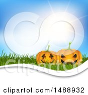 Sunny Sky And Halloween Jackolantern Pumpkins On Grass Background