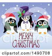 Clipart Of A Merry Christmas Greeting With Penguins Royalty Free Vector Illustration