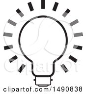 Clipart Of A Black And White Bright Light Bulb Royalty Free Vector Illustration by Lal Perera