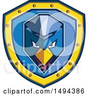 Clipart Of A Geometric Blue Chicken With A Mohawk In A Shield Royalty Free Vector Illustration