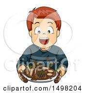 Boy Holding Up A Mud Pie With Sticks And Pinecones
