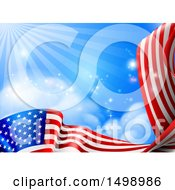 Poster, Art Print Of Rippling American Flag Under Blue Sky With Rays Of Sunshine