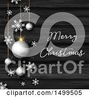 Merry Christmas Greeting With Snowflakes And Silver Bauble Ornaments Over Dark Wood