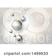 Silver Christmas Background Of Suspended Ornament Baubles With Snowflakes