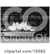 Modern Living Room Or Office Lobby Interior With A White Sofa With Tulip Shaped Back Rests And Chrome Poles Against A Cubic Wall