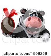 3d Business Holstein Cow Holding A Chocolate Egg On A White Background